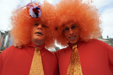 Two men wearing orange, the royal color, celebrated Queen Beatrix's abdication ceremony.