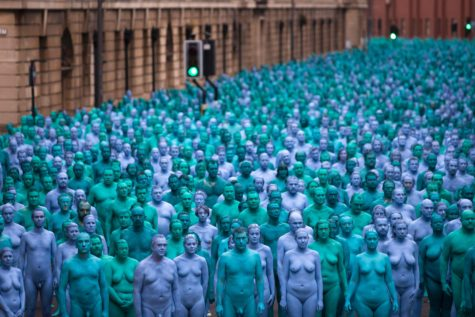 Naked volunteers, painted in blue
