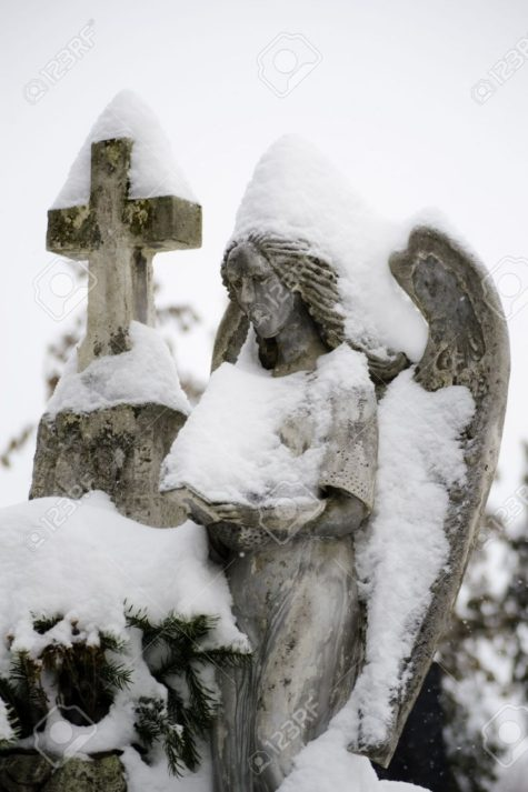12185037-Close-up-of-a-stone-angel-statue-covered-with-snow-Stock-Photo