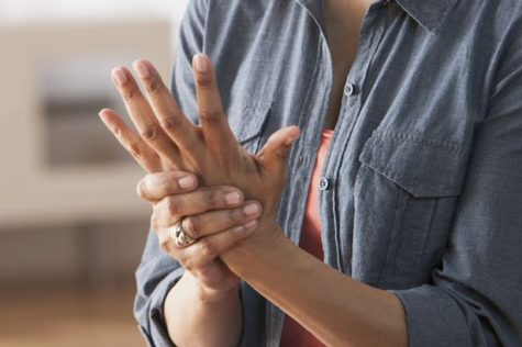 older-black-woman-rubbing-her-hands-arthritis