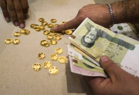 227145-a-customer-buys-iranian-gold-coins-at-a-currency-exchange-office-in-te